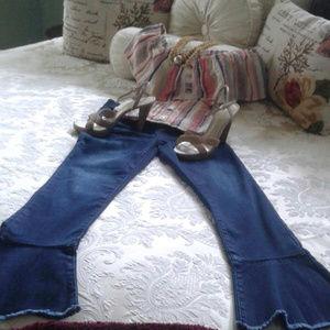 DARLING bebe ruffled bottom dark jeans